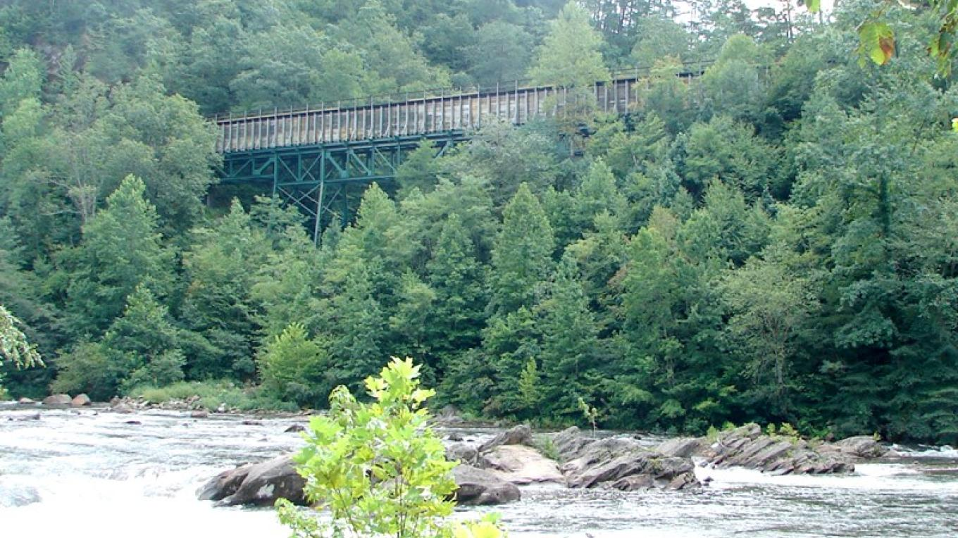 TVA's historic flume line carries the water of the Ocoee River to a powerhouse when the water is not running in the riverbed for whitewater rafting. – Ingrid Buehler