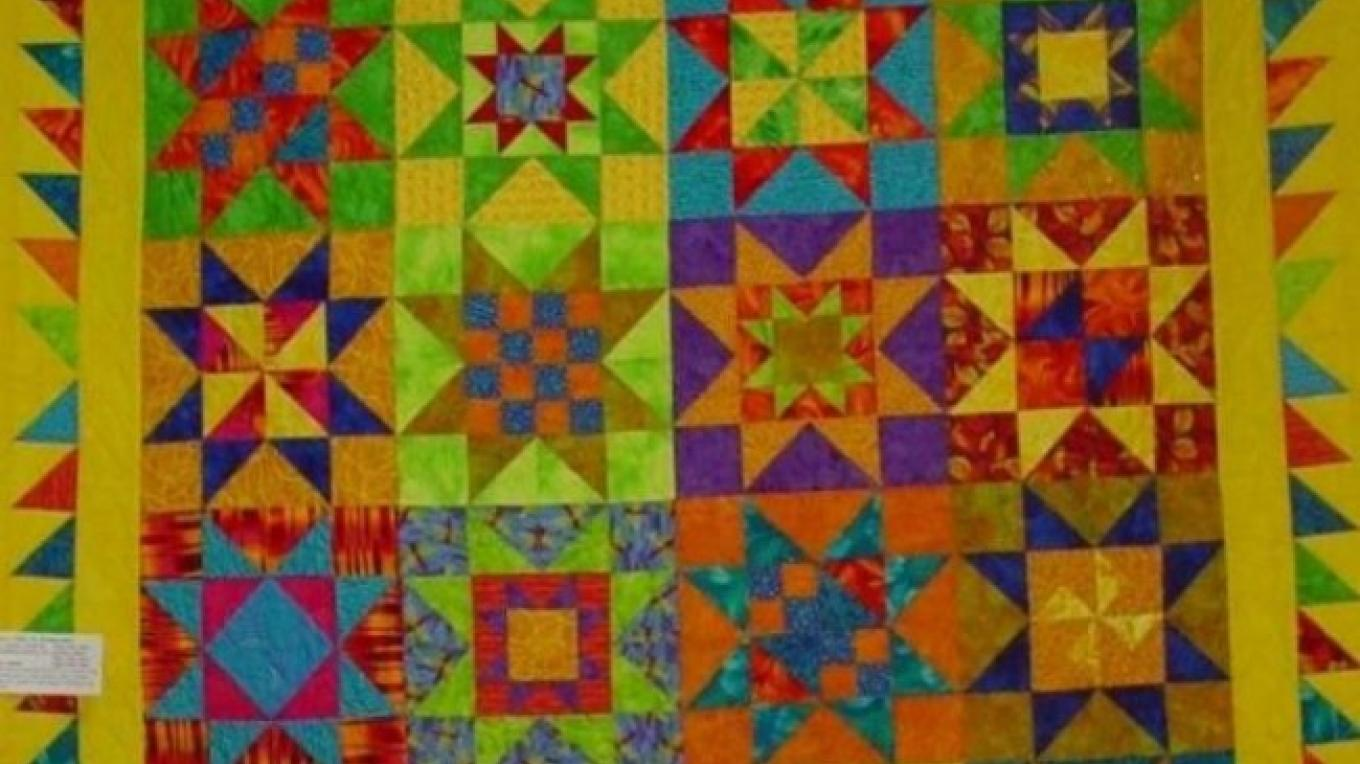 Our annual quilt show, held in the fall, draws entries and visitors from around the world.