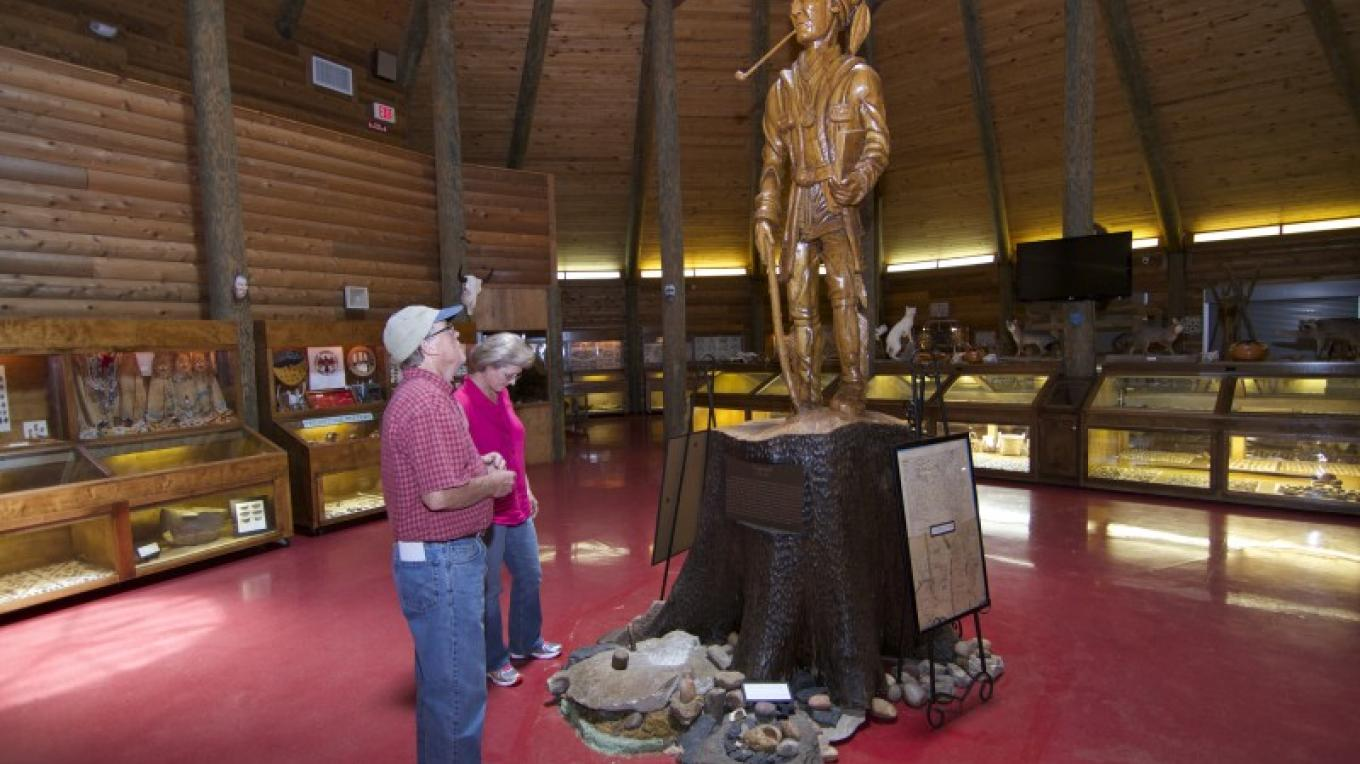 In the center of the museum is a spectacular wooden statue of the Cherokee legend, Sequoyah, created by David Goodlett, a local artist. – Brad Wiegmann
