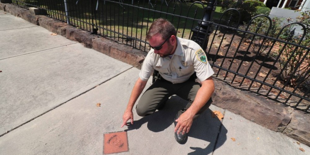 Park ranger points out marker. – Brad Wiegmann