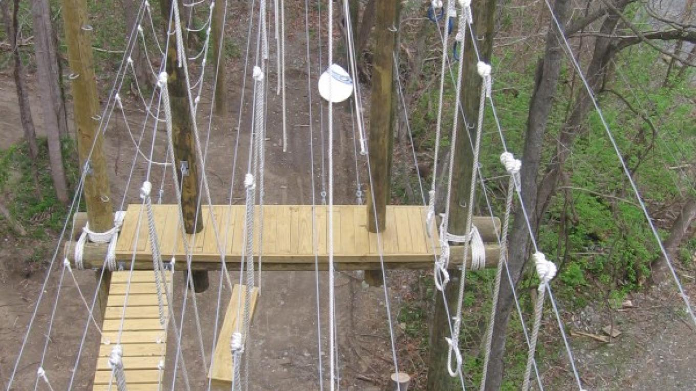 Aerial view of our ropes/challenge course at our river outpost in Hartford, TN. – Beth Justice