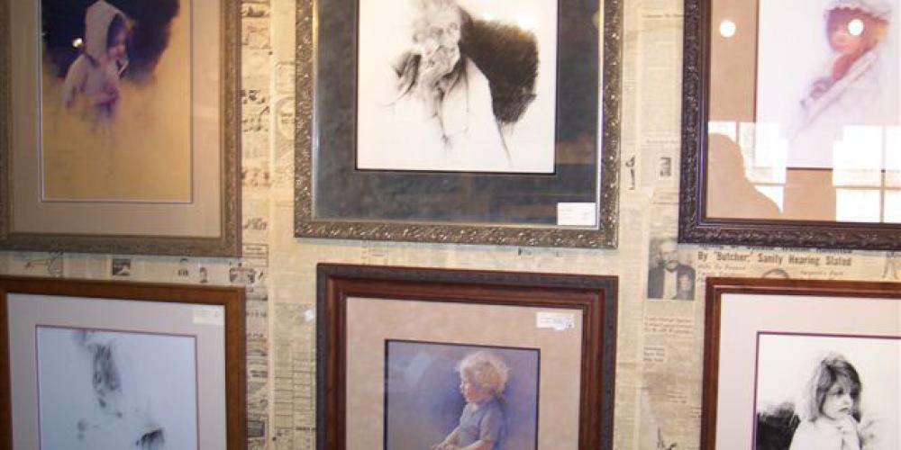 inside the gallery, old newspaper on walls – kjm