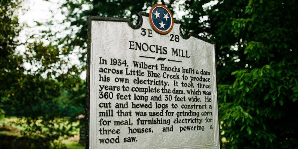 The mill building, water impoundment, and mill race were all constructed by Wilbert Enochs to serve as a grist mill for the area and as an electrical generator for his home and three others nearby. – Cari Griffith