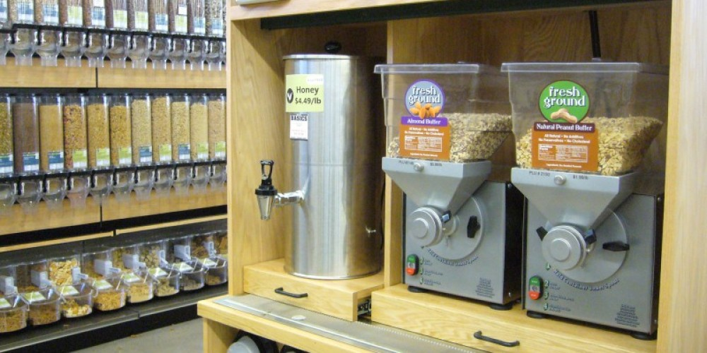 Grind your own nut butter stations next to bulk honey, olive oil, and soy sauce. All situated within Three Rivers Market's expansive bulk section. – Three Rivers Market