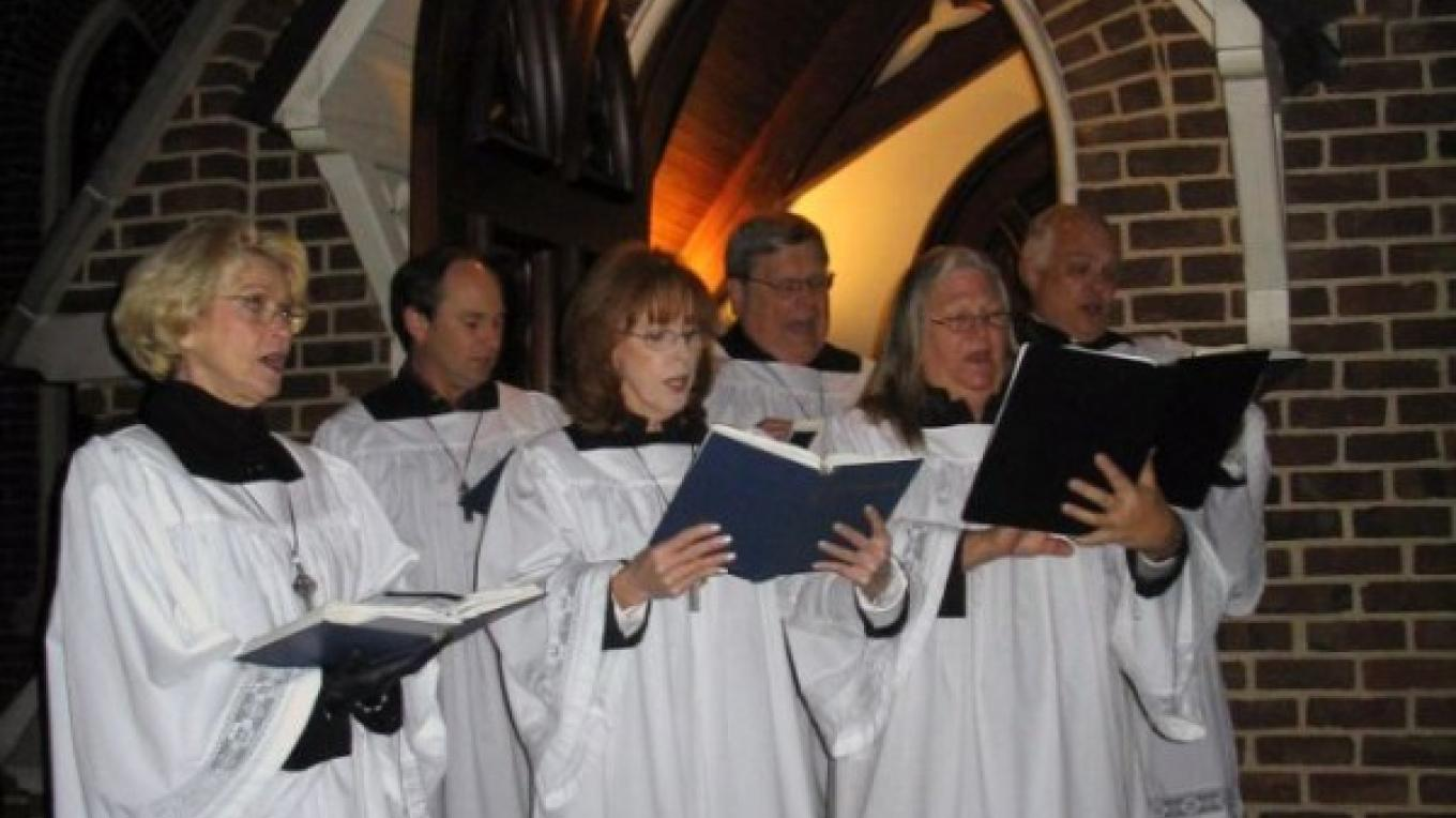 The sounds of Christmas fill the air from the steps of historic St. Luke's Episcopal Church. – Melissa Woody