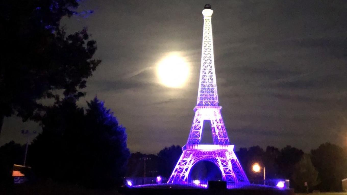 It's difficult for the Eiffel Tower to compete with a Harvest Moon.
