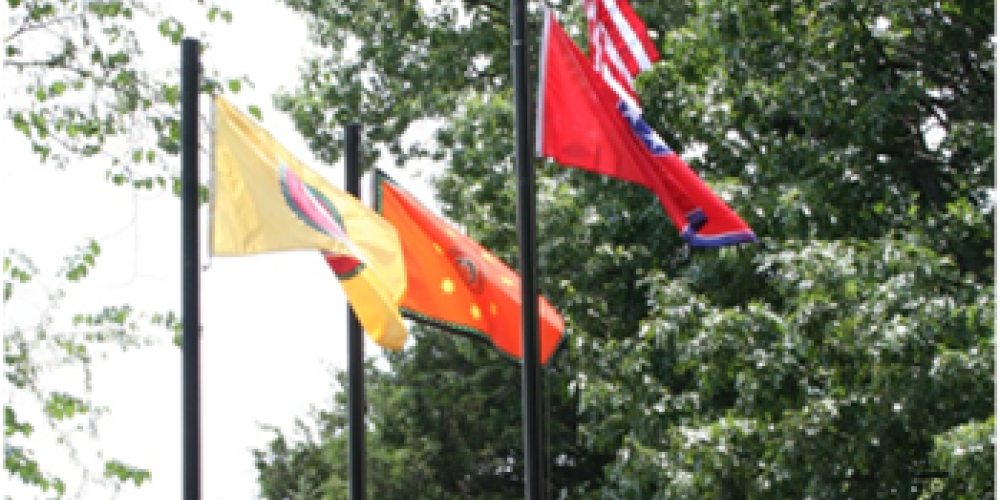 Flagpoles at the front of the cemetery display the flags of the United States of America, the State of Tennessee, the Cherokee Nation (based in Oklahoma) and the Eastern Band of the Cherokee Nation (based in North Carolina). – Bettie Purcell