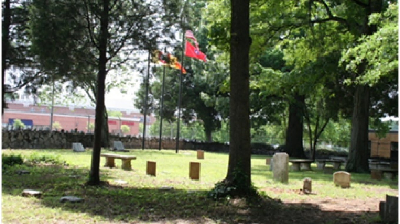 View of flags and gravestones looking across to the front of Brainerd Mission Cemetery – Bettie Purcell