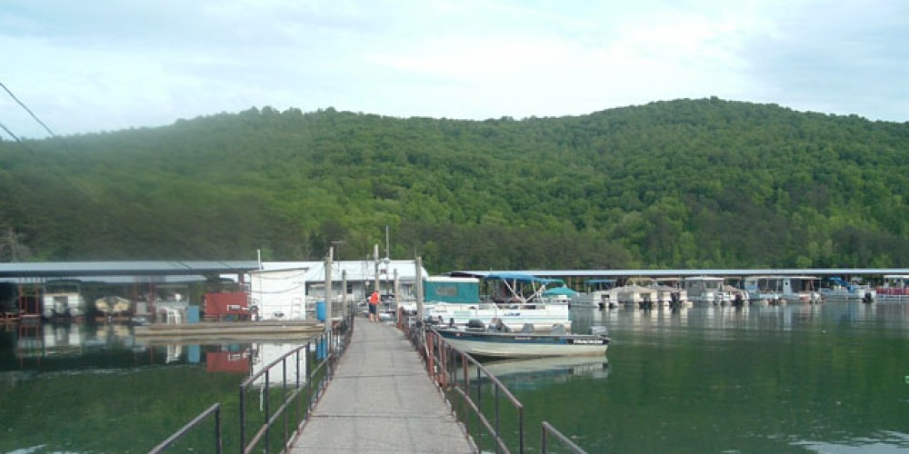 Our sturdy walkway leads to our shop and boat slips.