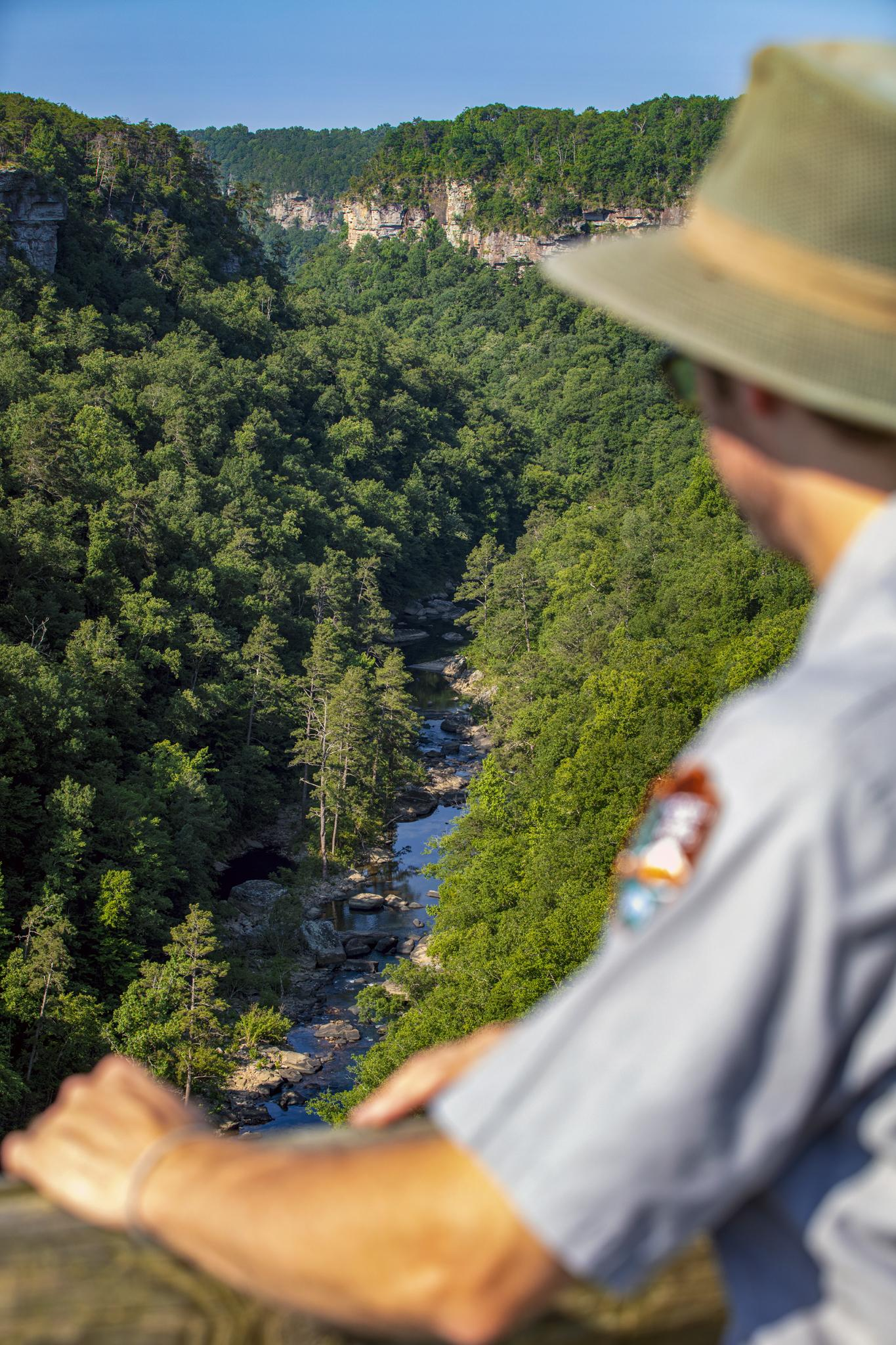 A National Park Service ranger casts a gaze from one of the many viewpoints overlooking Little River Canyon. – Scott Baker