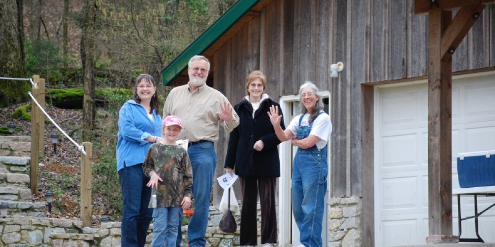 Gayle Tanner (far right), owner, poses with visitors – John Nichols