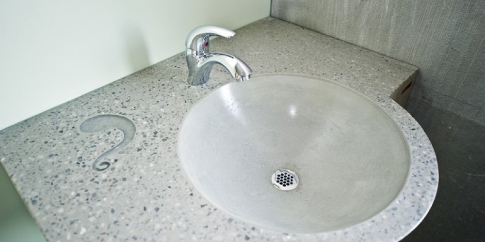 Our private rooms each have a unique sink by local concrete caster Set In Stone (concretecaster.com). This piece was a collaboration with another local artist, Ignis Glass Studio (ignisglass.com) who provided the glass. – Mandy Rhoden