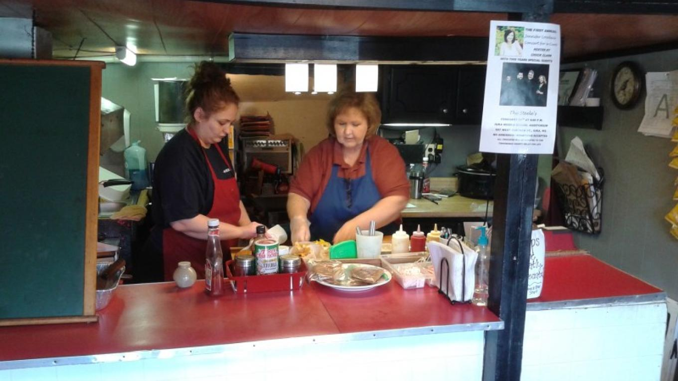 Maddy and Genice prepare burgers. – James Gibson