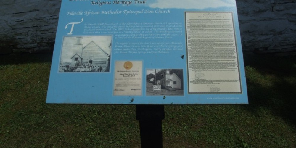 An informational sign outside the church explains the history of the structure. – Paul Archambault