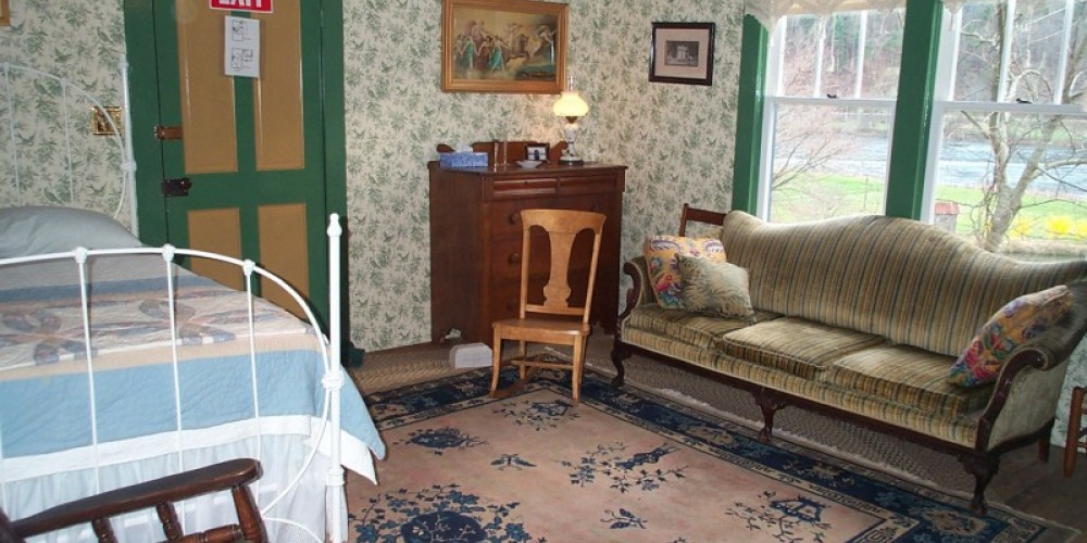 Rooms are furnished in keeping with the time period of the cottage. – Ingrid Buehler