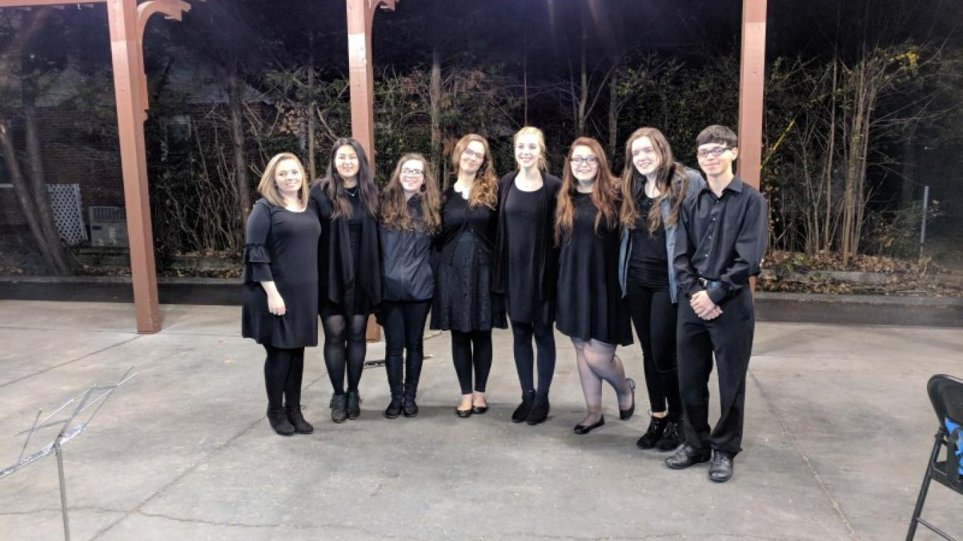 DCHS Tri-M Music Honors Society performed beautiful instrumental Christmas music. – Esther Wood