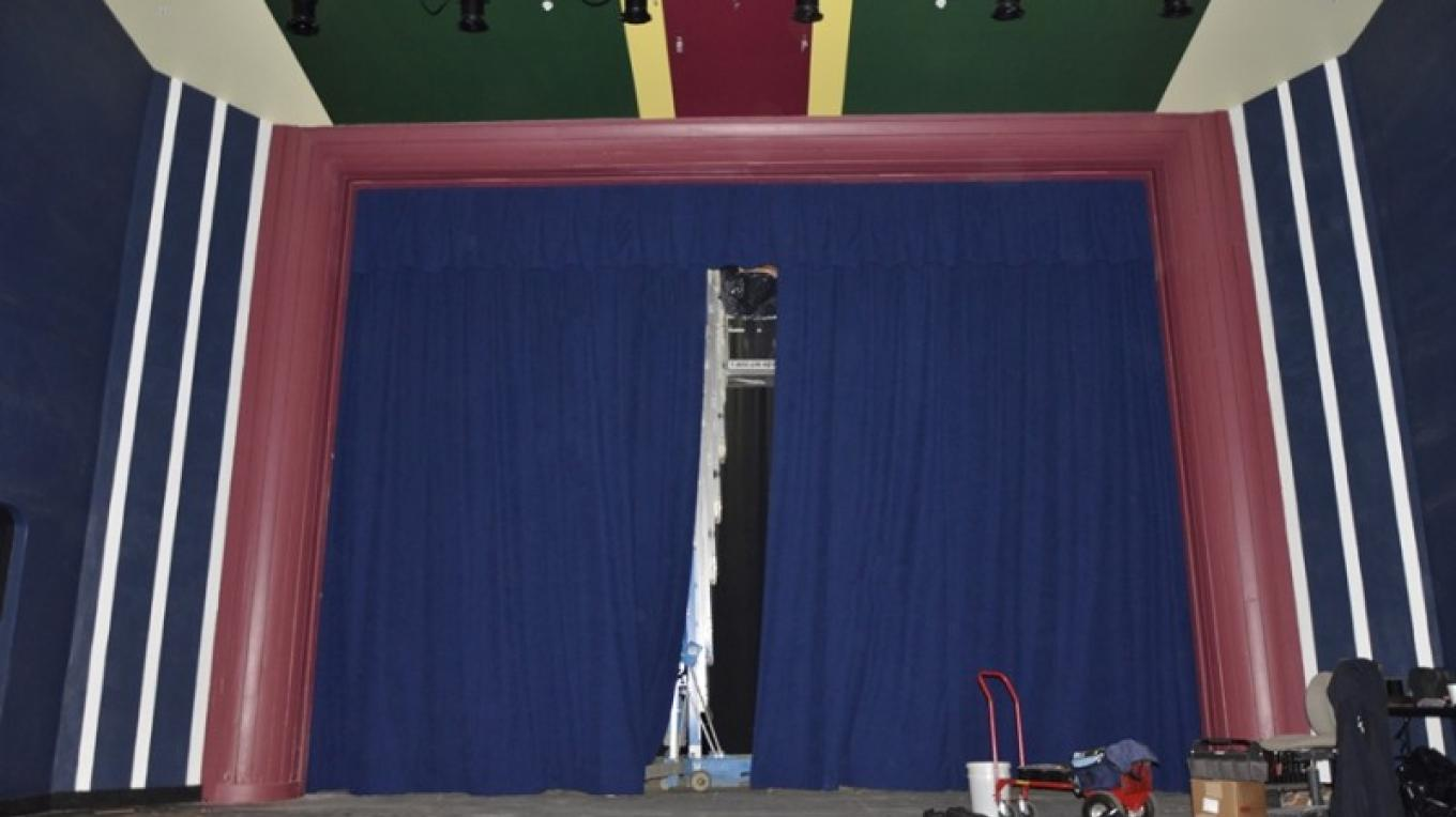 The new fire-retardant blue cotton curtain was hung recently...another milestone in the restoration. – J. Paul Mashburn