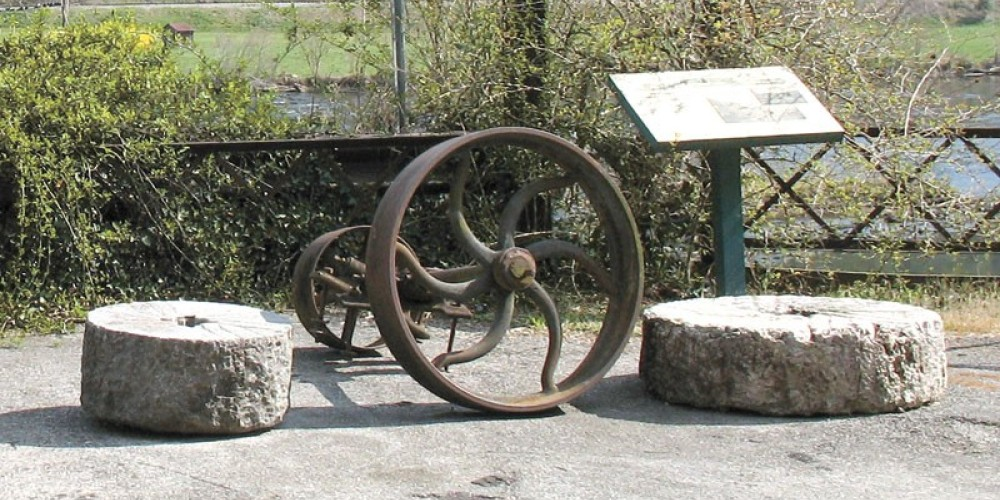 Remnants of the old mill lie outside the store. – Ingrid Buehler