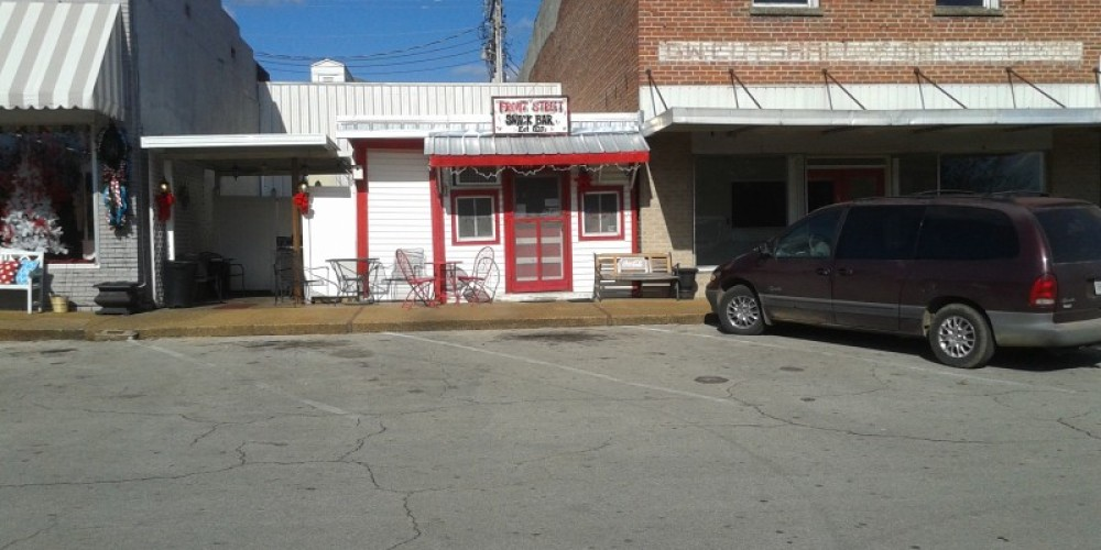 The Front Street Snack Bar is wedged in between two buildings. – James Gibson