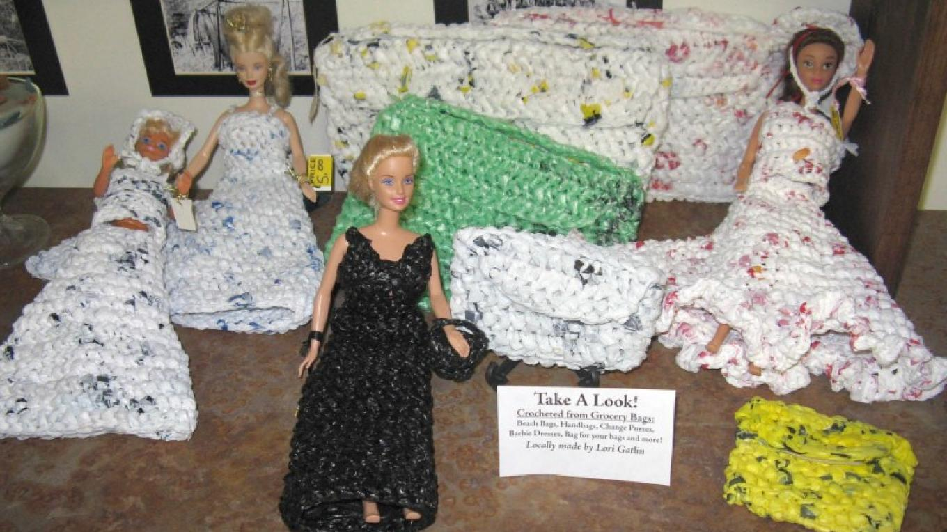 Dolls with dresses crocheted from grocery bags and crocheted handbags give new life to old bags. – Cheryl Maxwell