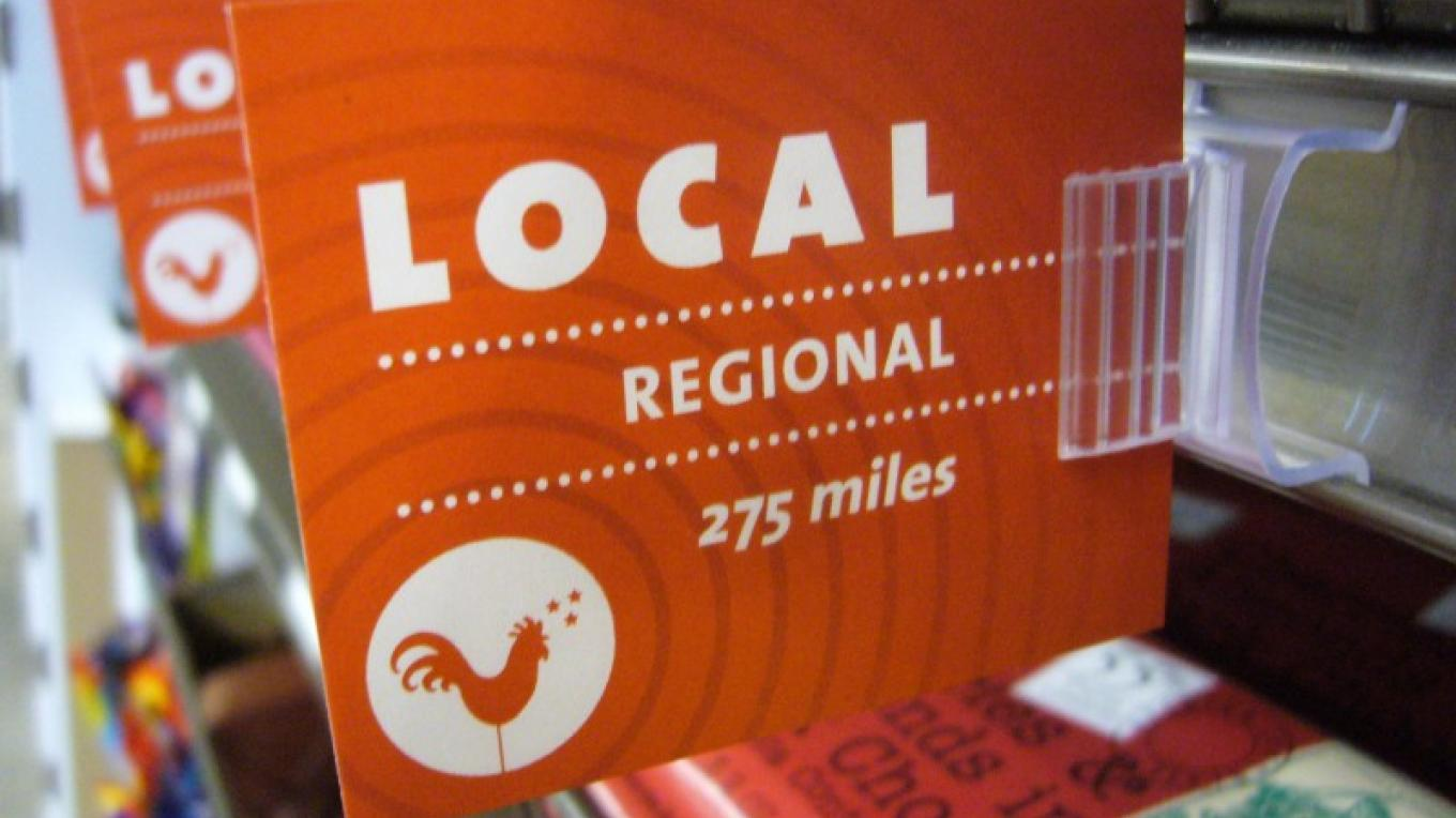One of the signs in Three Rivers Market designating a product made or grown within 275 miles of Knoxville or within the state of Tennessee. – Three Rivers Market