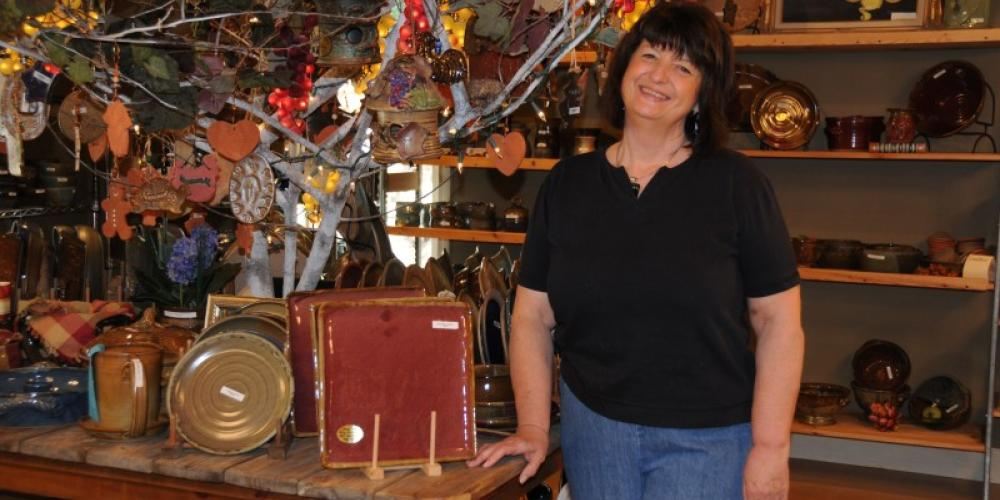 Owner Valinda Miracle poses with some of her creations. – John Dersham