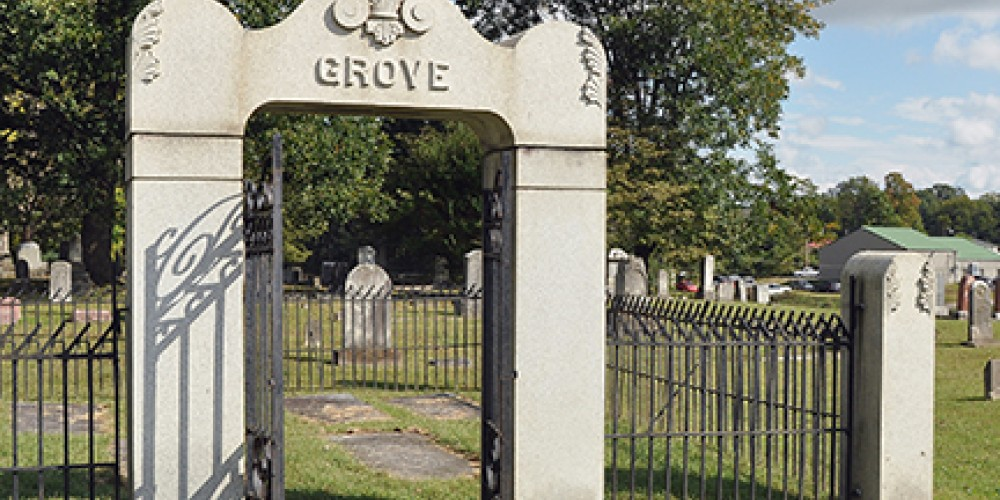 Members of the the Grove family lie under full length, flat, grave markers, each beautifully inscribed. – Jean Owens