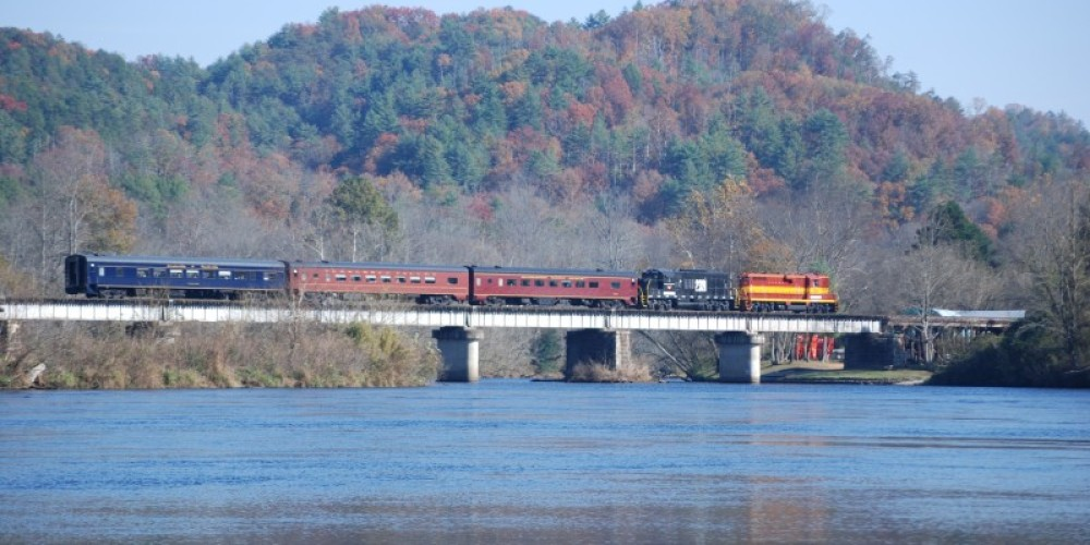 Train in fall crossing bridge in Reliance – Jim Caldwell