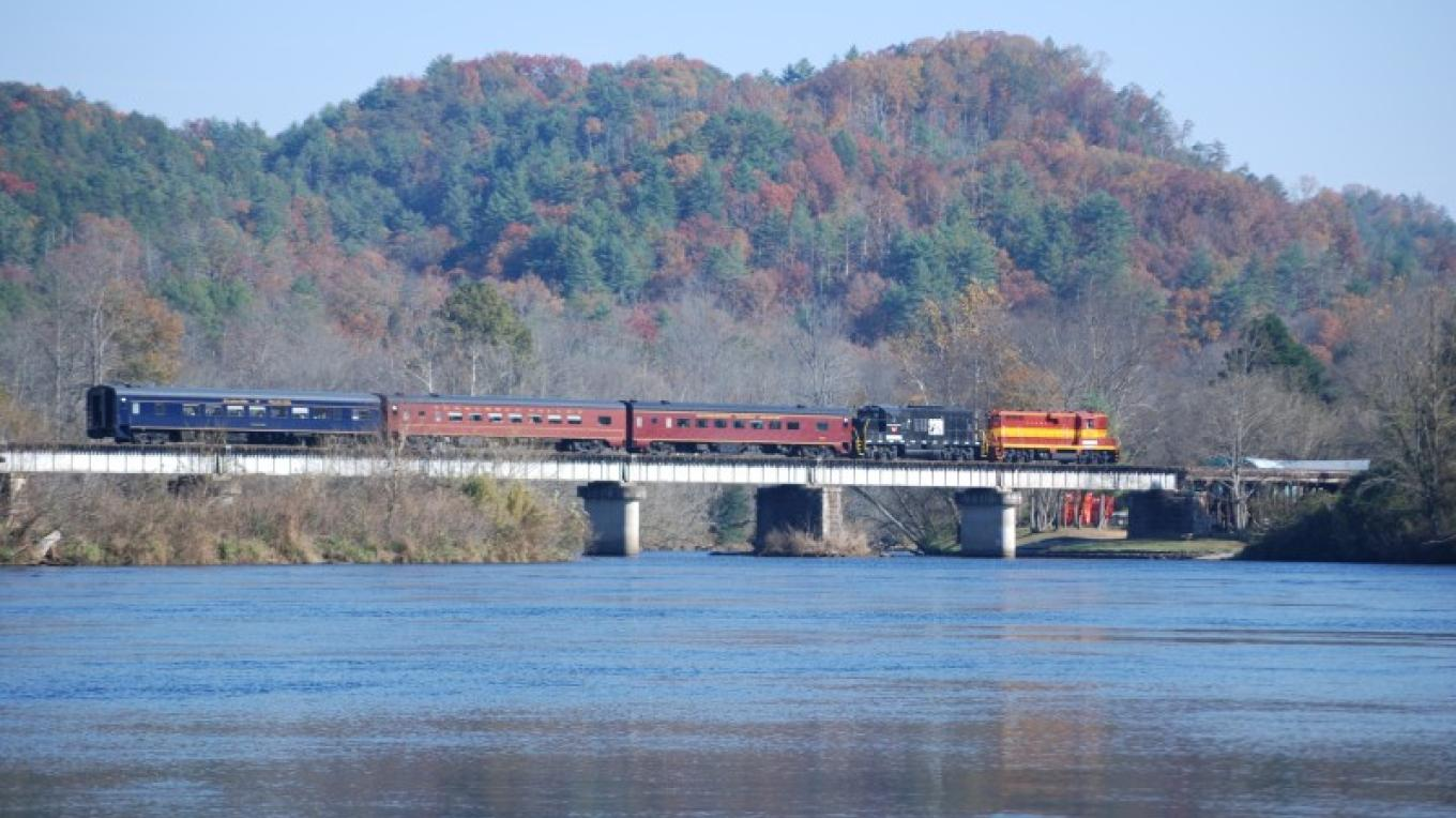 Train in fall crossing bridge in Reliance – Jim Caldwell