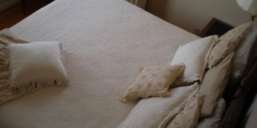 Typical king bed. – Radonna Parrish