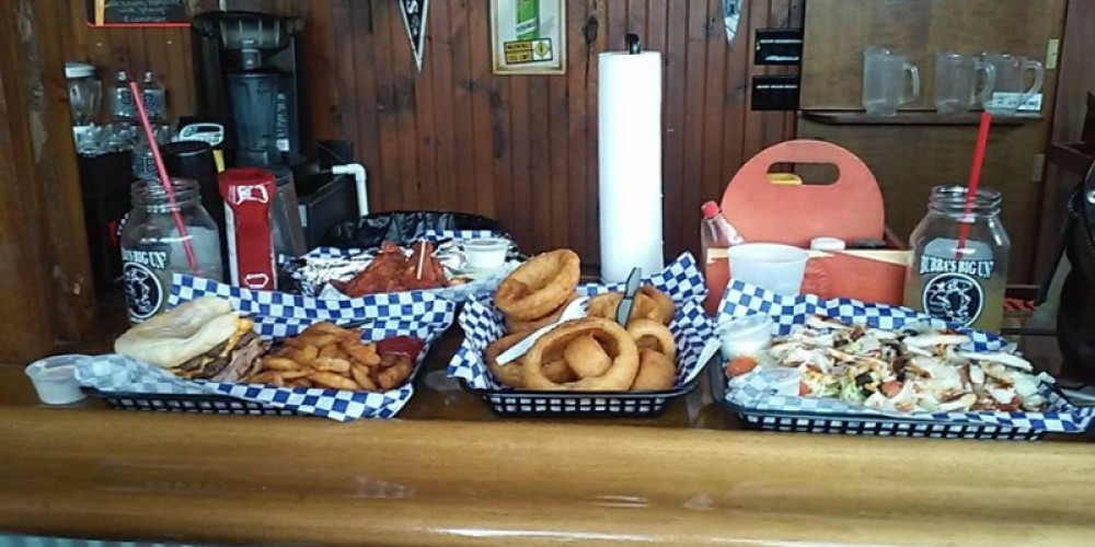 Check out our menu ! From onion rings to pizza and wraps we got it all.