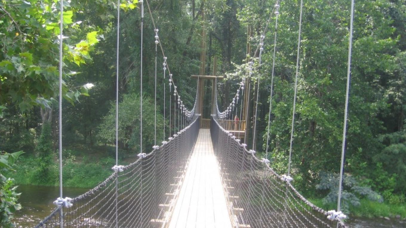 Footbridge to zipline towers and Family Adventure Island. – Brenda Shultz