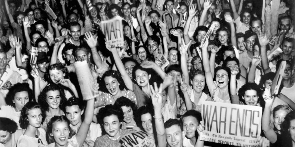 """A mass of people gathered at """"Townsite,"""" now Historic Jackson Square, when news came of the end of WWII. – DOE Photo by Ed Westcott"""
