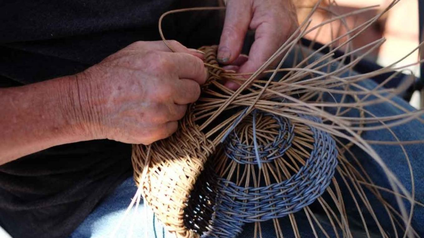 Skilled craftsmen work on projects at the Festival