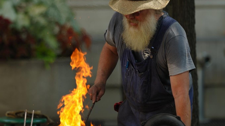 Mike Rose demonstrates blacksmithing. – Dan MacDonald