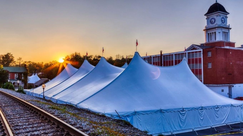 Festival tents at dusk. – Jay Huron